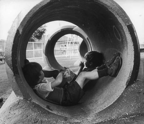 Mark Deegan and James Thomas at a playground in 1971.